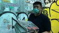 Hong Kong Residents Eager to Buy Newspaper Raided by Police