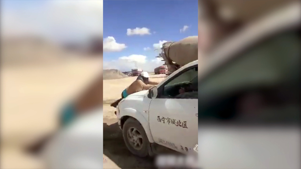 Chinese Worker Rams Tibetan Protester with Truck