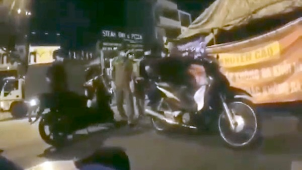 Viral Video Shows Vietnam Police Beating Man at COVID-19 Checkpoint