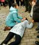 Daughter Beaten Amid Protests Outside Shandong Court During Father's Trial