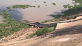 Cambodian River Flowing With Sewage