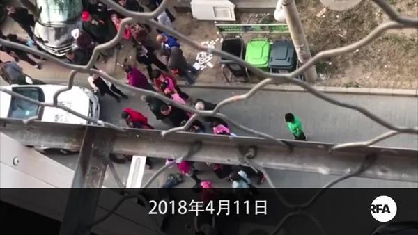 李文足續軟禁 王峭岭探望遭推撞 記者採訪被打