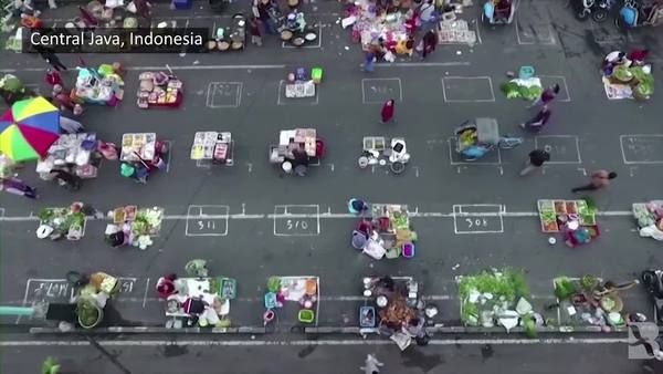 Masks and no touching: Indonesia aims to keep markets alive