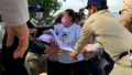 Police manhandle demonstrators at the French Embassy in Phnom Penh