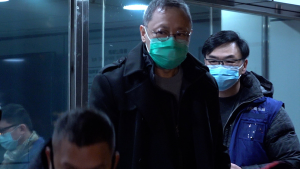 Democracy Activist Benny Tai Departs Hong Kong Police Station on Bail After Mass Arrest