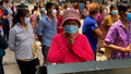 Residents Gather to Plead for Food Aid as COVID-19 Lockdown Grips Phnom Penh