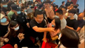 Chinese Students Clash with Police in Protest over Plans to Force College Mergers