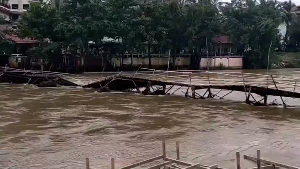 Flooding Washes Away Popular Tourist Bridge in Laos