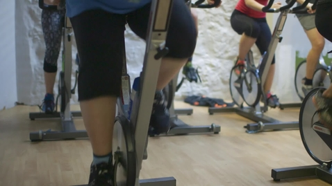 Thumbnail for entry People of different sizes on exercise bikes