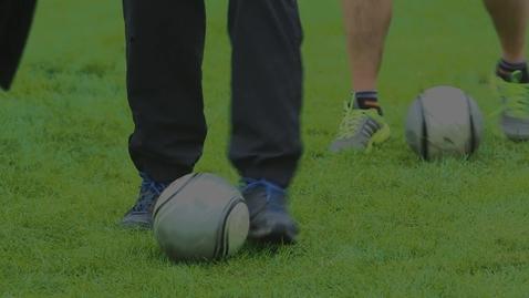 Thumbnail for entry Men kicking footballs