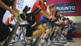 Thumbnail for entry Men and women on exercise bikes