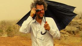 Vorschaubild für Eintrag Knistern der Zeit - Christoph Schlingensief und sein Operndorf in Burkina Faso