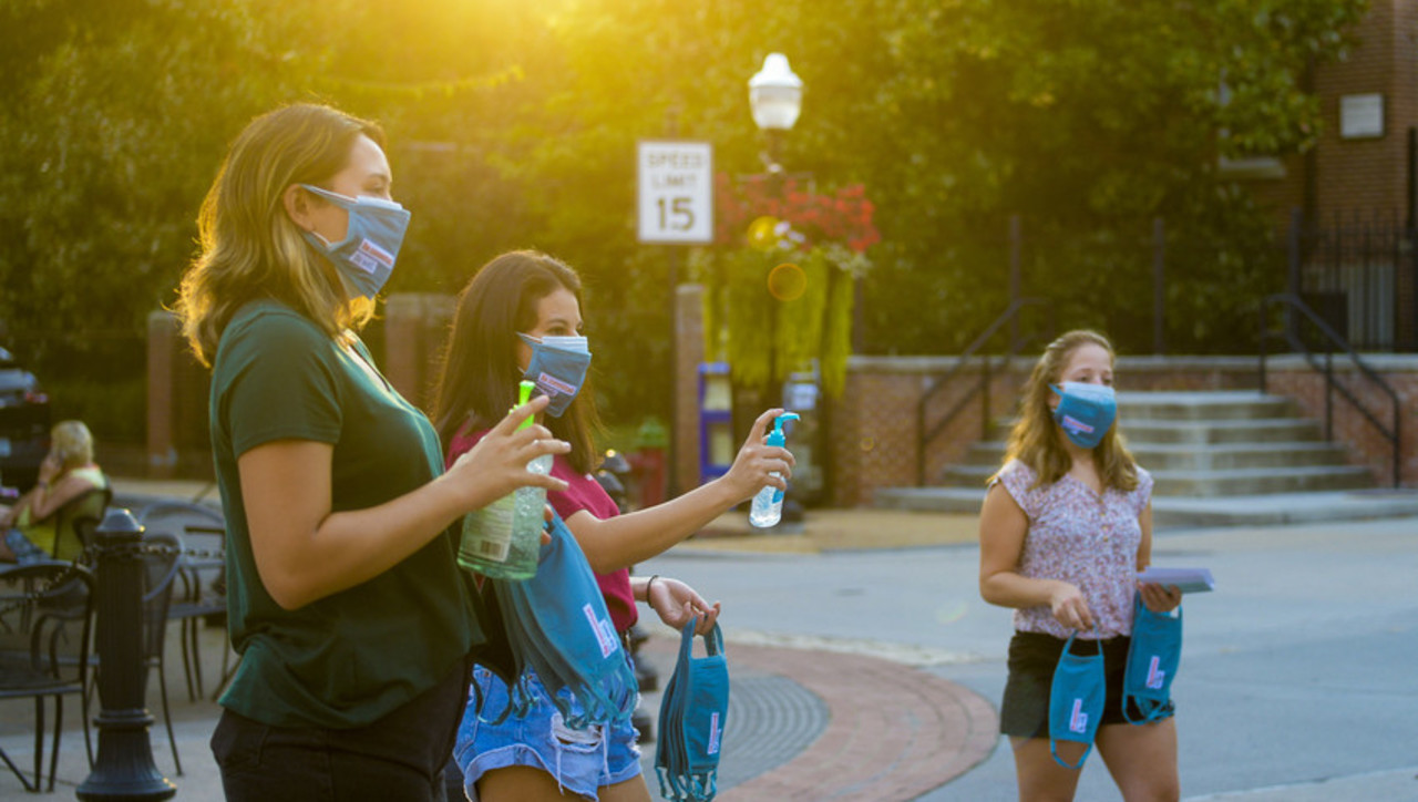 Students share COVID-19 resources in downtown Blacksburg