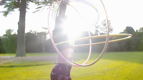 Thumbnail for entry Fastest 100 m on roller skates while spinning three hula hoops