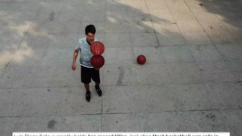 Thumbnail for entry Most basketball arm rolls in one minute (three basketballs)