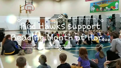 Thumbnail for entry Red Hawks support Reading Month at Horace Elementary