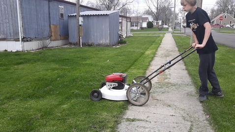 """Thumbnail for entry Mowing grass with the Craftsman 03LE 22"""" limited edition push mower."""