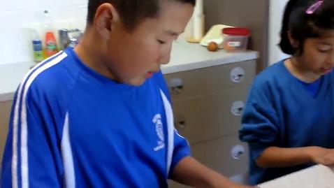 Thumbnail for entry Mika and Tetsuya making sushi