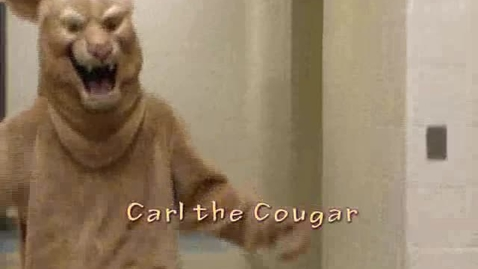 Thumbnail for entry Carl the Cougar learns a lesson on the piano