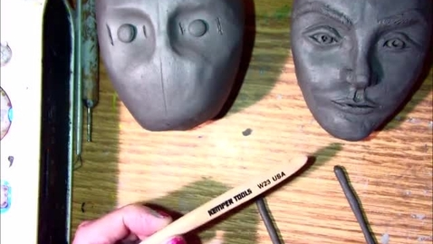 Thumbnail for entry clay face eyes nose