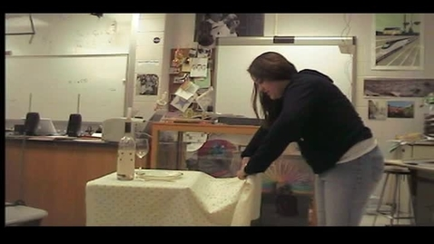 Thumbnail for entry student doing tablecloth trick